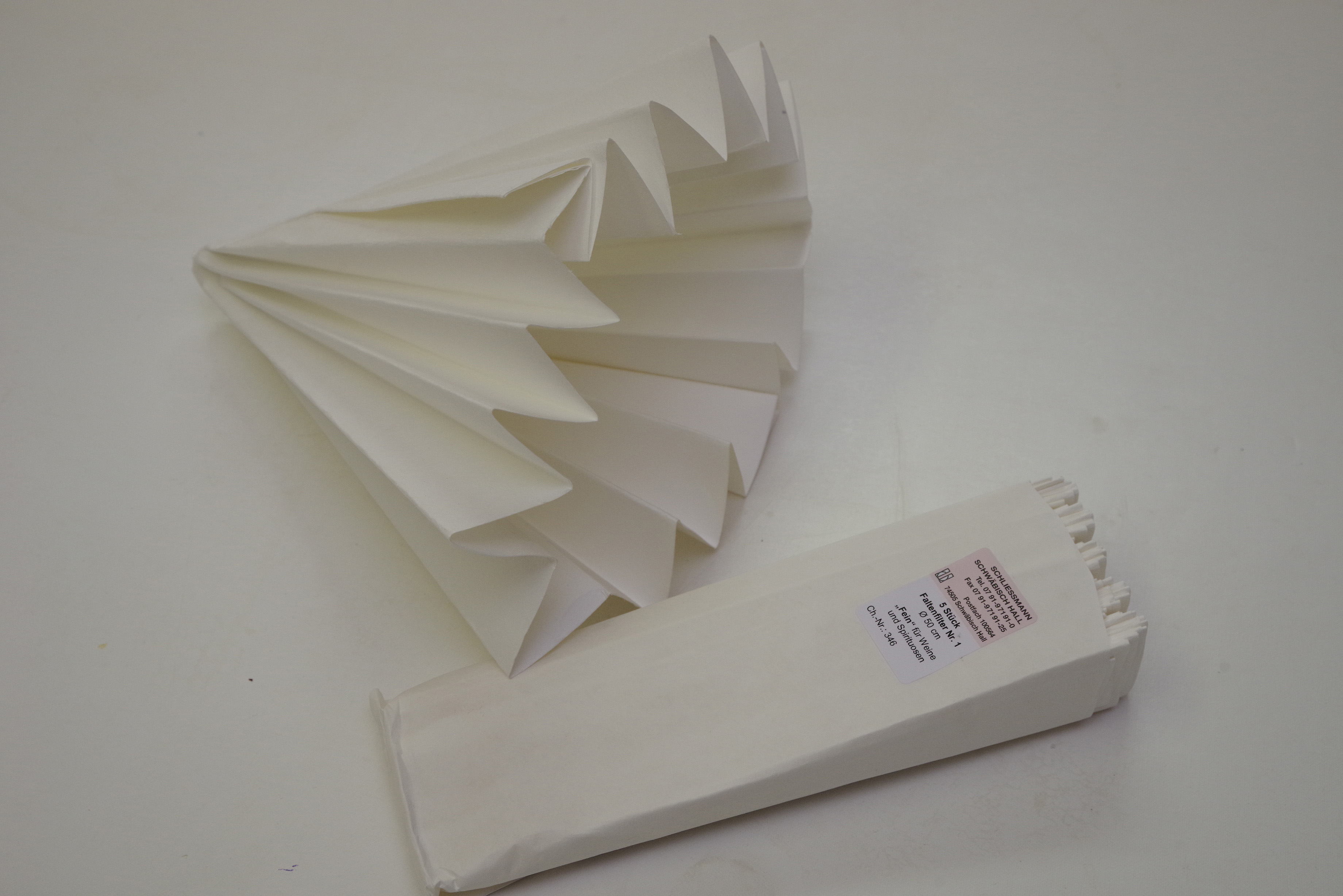 Pre-Folded Paper Filters